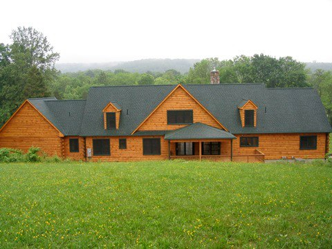 Custom Log home and log siding in the gable ends.
