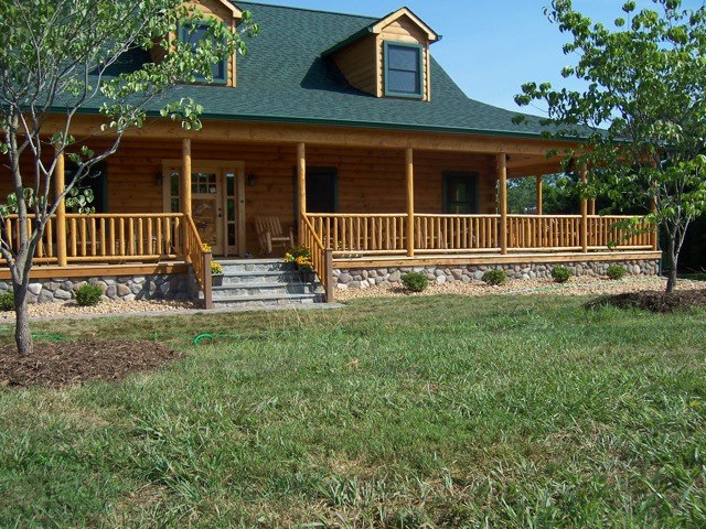 Log home photos wholesale log homes for Log cabin porch