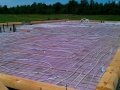 Radient floor heat installed prior to concrete slab for this custom log home in Ontario, Canada