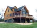 """Custom log home using 8"""" tall x 6"""" wide D logs with dovetail corners."""