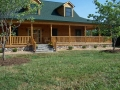 Custom log home with a great front porch located near Front Royal, VA.