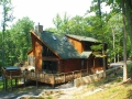 Custom designed log home using 8″ x 6″ logs and log siding.