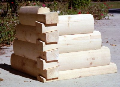 8×6 Round Flat D Logs with Dovetail Corners