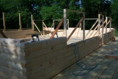 54-8x6-round-flat-d-logs-dovetail-corner-under-construction
