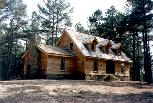 Log homes wholesale logs for log homes shipped direct for Pictures of log houses