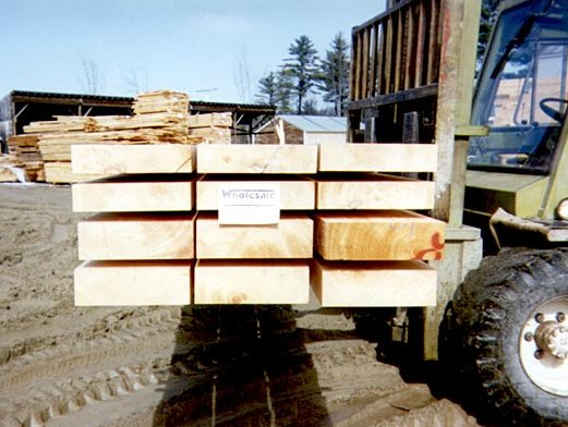 Planed heavy timbers for log cabins and homes.